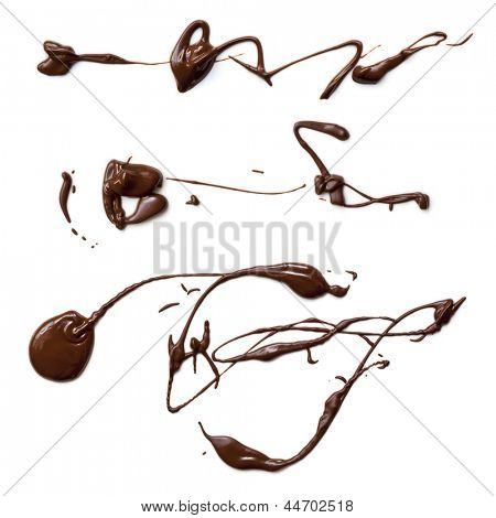 Melted chocolate splashes, isolated on white background.