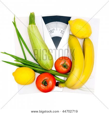 Diet and nutrition. Vegetables and fruits on the scales