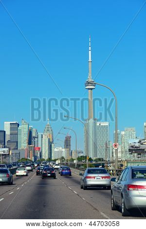 TORONTO, CANADA - JULY 3: Toronto highway with cityscape on July 3, 2012 in Toronto, Canada. Toronto with the population of 6M is the provincial capital of Ontario and the largest city in Canada.