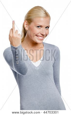 Woman in gray pullover showing obscene gesture, isolated on white