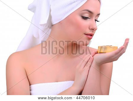 Beautiful young woman with aroma soap isolated on white