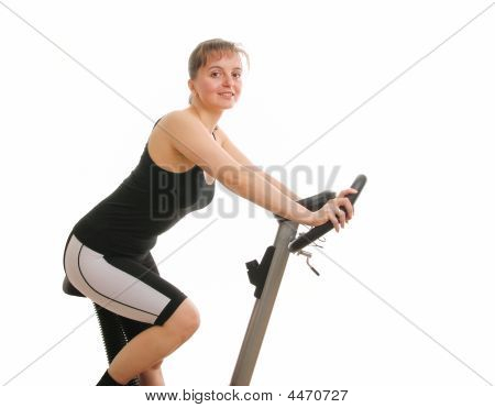 Fitness Woman Exercising On Bicycle From Back - Isolated