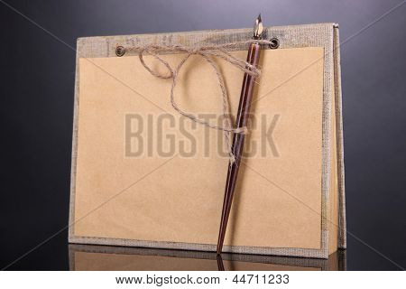 Beautiful old notebook on grey background