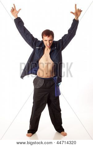 Young adult male swimmer cheering on teammates. Studio shot over white.