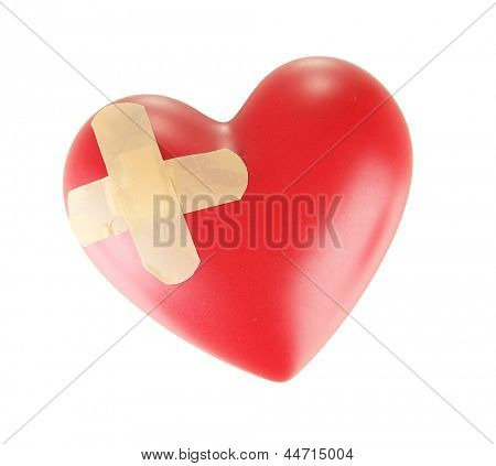 Heart with plaster, isolated  on white.