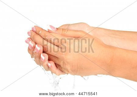 Washing woman's hands on white background close-up