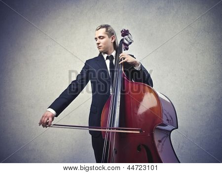 young musician playing contrabass
