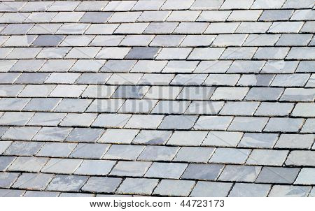 Background of gray or grey slate tiled roof.
