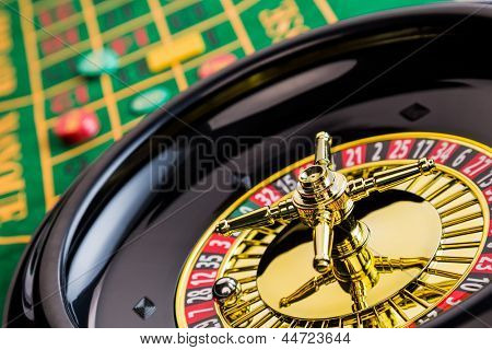 the cylinder of a roulette gambling in a casino. profit and loss is decided by chance.