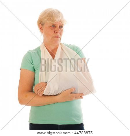 Old woman with broken wrist in blue gypsum isolated over white background