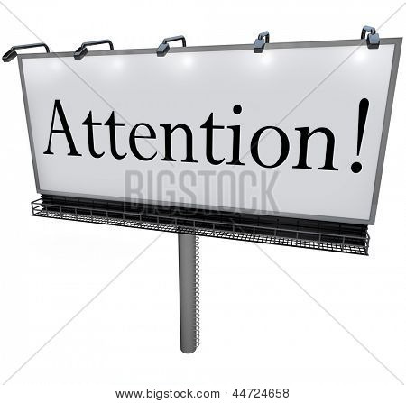 The word Attention on a big outdoor advertisement billboard to communicate a special announcement or urgent message to the public or customers