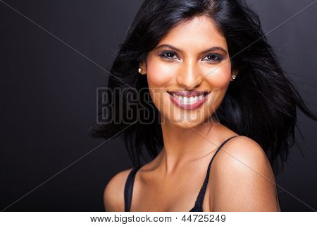 close up portrait of beautiful young indian model isolated on black background