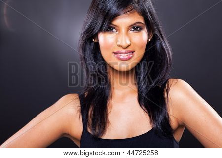 beautiful young indian woman close up over black background
