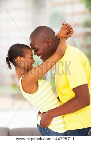 passionate young african couple flirting and having fun