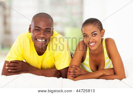 close up portrait of young african couple in bed