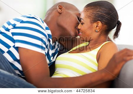 close up portrait of young african couple kissing