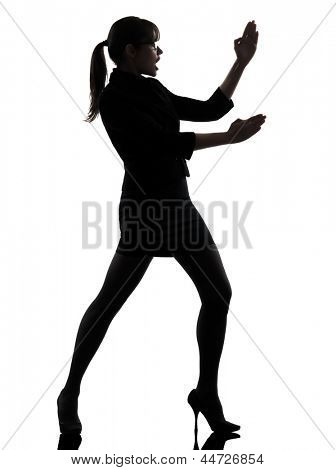 one business woman karate self defense  silhouette studio isolated on white background