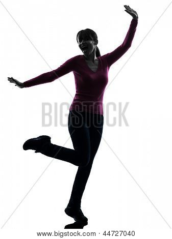 one caucasian woman happy stretching   in silhouette studio isolated on white background