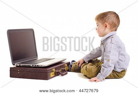 Cute boy looking at laptop screen