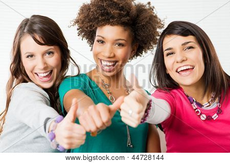 Group Of Happy Young Friends Showing Thumb Up Sign