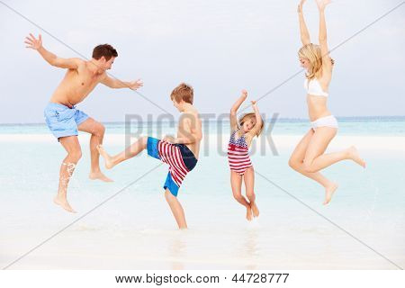 Family Having Fun In Sea On Beach Holiday