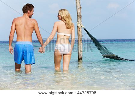 Romantic Couple Standing In Beautiful Tropical Sea