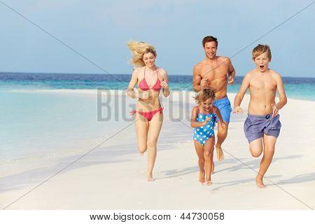 Family Having Fun On Beach Holiday