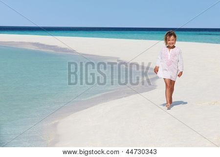 Girl Walking On Beautiful Tropical Beach