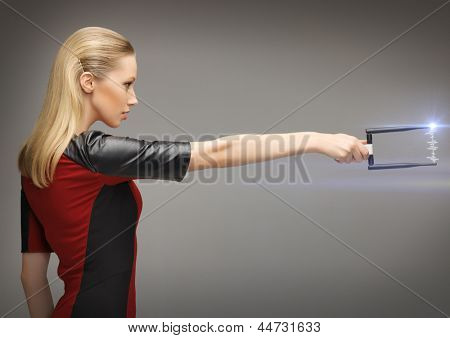 picture of futuristic woman with sci fi weapon