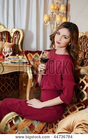 The elegant woman with wine glass at smart restaurant