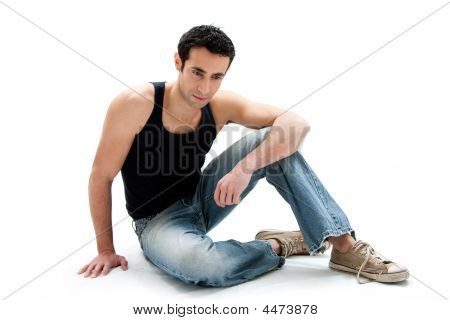 Handsome Guy Sitting On Floor