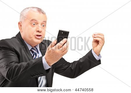 A displeased manager in suit screaming on a mobile phone isolated on white background