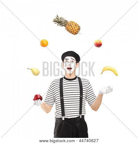 A smiling mime artist juggling fruits isolated against white background