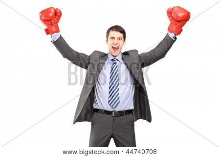 Young man in a suit and boxing gloves, celebrating a win, isolated on white background