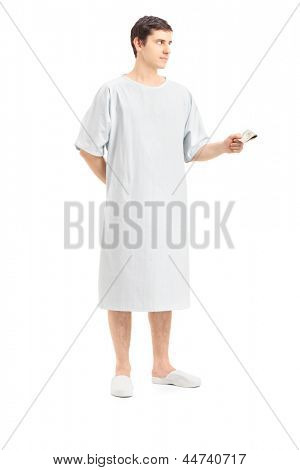 Full length portrait of a male patient offering money, isolated on white background