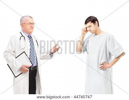 Mature doctor talking to a worried male patient, isolated on white background