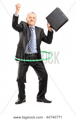 Full length portrait of a matue businessman dancing with a hula hoop, isolated on white background