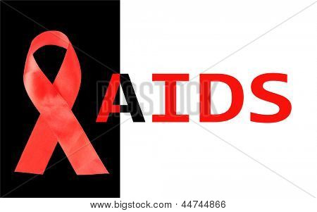 Aids awareness red ribbon isolated on black with aids word