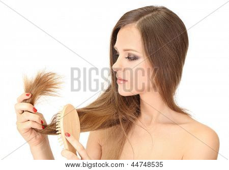 Beautiful woman holding split ends of her long hair, isolated on white