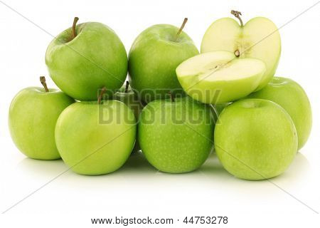 """freshly harvested """"Granny Smith"""" apples and a cut one  on a white background"""