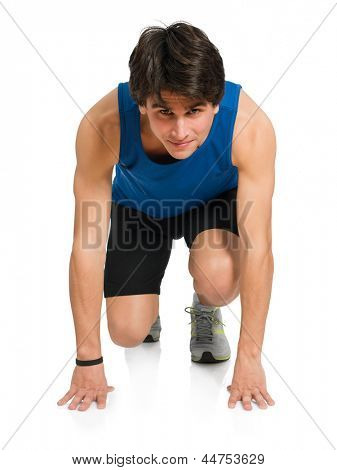 Young Man Ready To Start A Race Isolated On White Background
