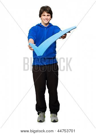 Young Man Holding Tick Mark Isolated On White Background