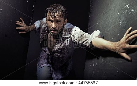 Man wearing dirty clothes