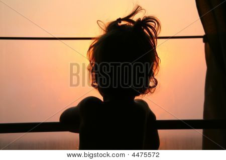 Silhouette Of Child In Window Of Train