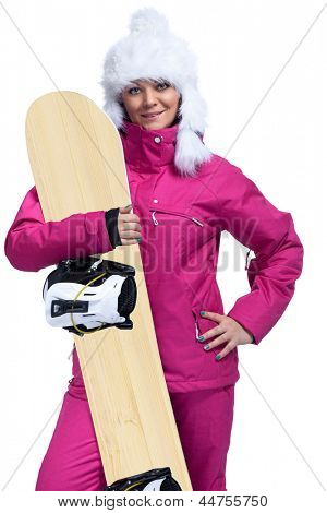 Smiling woman with snowboard posing over beautiful landscape