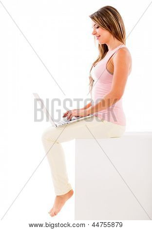 Woman using a laptop computer - isolated over white background