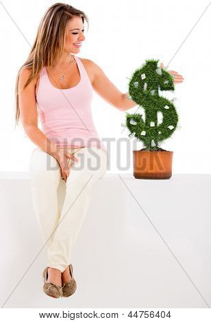 Woman nurturing a money plant - isolated over a white background