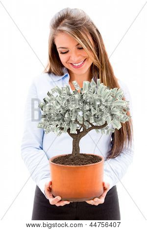 Business woman nurturing a money tree - isolated over white background
