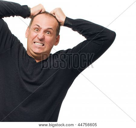 Portrait Of Angry Man Pulling His Hair On White Background
