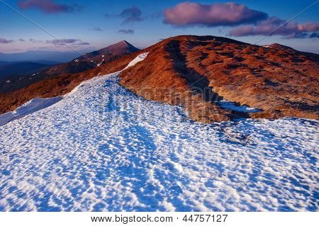 Snowfield in the mountains in the spring